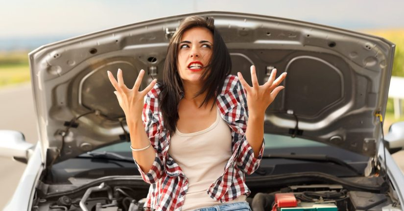 Frustrated lady in front of her broken down car with the bonnet open. CanYa has mechanics that can help out in an instant.