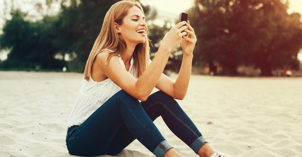 A CanYa User is happily using the CanYa App to book a local service provider near her